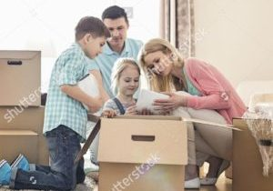 stock-photo-family-unpacking-cardboard-boxes-at-new-home-549205603-sq